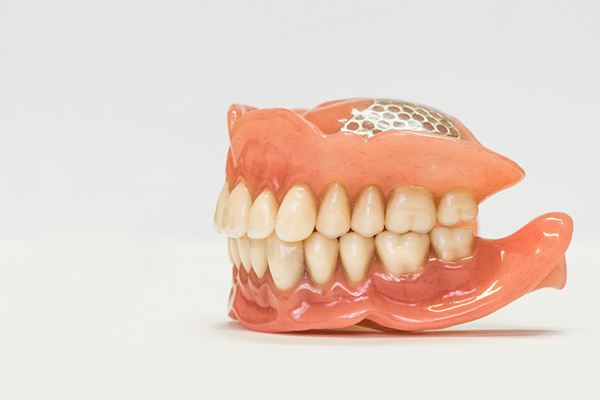Dentures on a white background from Medhat Dental Excellence in Chicago, IL